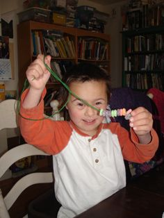 Alphabet Activity for the letter O - Stringing Os (Fruit Loops) - From www.wordsofhisheart.com - a blog about visual learning, homeschool preschool, speech therapy and Down syndrome.  This is a classic fine motor activity but it's great practice for pincer grasp and in this entry it's tied in to the letter O.