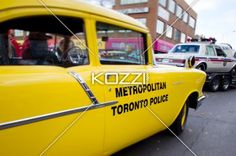 view of yellow police car. - View of yellow police car at Christmas parade.