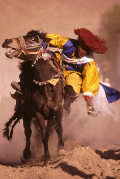 Tibetan Horseman - A Horse riding competition in small remote village in Mt. Everest region of Central Tibet