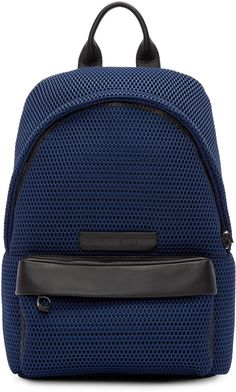 Lightly structured mesh backpack in navy. Buffed leather trim throughout in black. Folded carry handle at top. Adjustable padded shoulder straps. Leather logo patch and zippered compartment at face. Two-way zip closure at main compartment. Zippered pocket at interior. Textile lining in black. Silver-tone hardware. Tonal stitching. Approx. 12