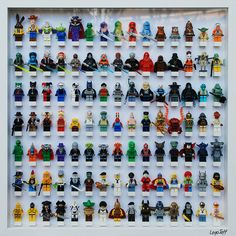figurines lego storage - framed as wall art for boys room or man cave (big bang theory geeky man cave!) (or girl cave!) I want to do this for my hubby.and possibly my future son(s). Legos, Deco Lego, Lego Frame, Figurine Lego, Lego Display, Lego Room, Lego Storage, Ideias Diy, Kids Room