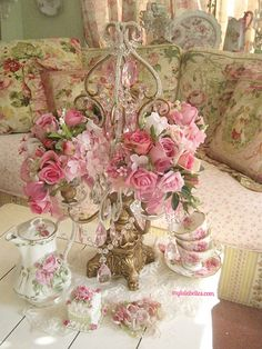 Shabby candelabra with rose balls in place of candles