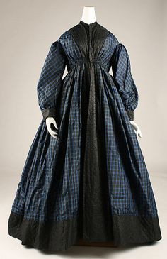 Robe, blue plaid silk, American, 1845-1855. Front bodice and skirt in full length panels; back bodice with gathered skirt panels attached. Robe has drawstring channels at waistline which rises high in front. Quilted silk is applied from neck to hem and encircles garment. Bishop sleeves with quilted silk cuffs. MET