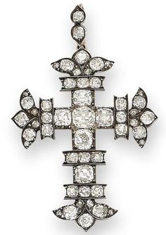 An early 19th century diamond cross pendant, circa 1820 The cross fleury set throughout with cushion-shaped diamonds, mounted in silver and gold, diamonds approximately 9.00 carats total, detachable suspensory loop, pendant length 6.2cm.