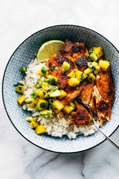 BBQ Salmon Bowls with Mango Avocado Salsa! An easy and impressive dinner with yummy smoky-sweet flavor and a zip of zesty homemade salsa to take it over the top. The BEST weeknight dinner. #salmon #dinner #seafood #bbq | pinchofyum.com