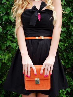 Pair a matching clutch and belt with a simple black dress for a flirty and fun party dress