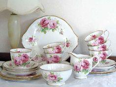 This is the beautiful Royal Albert 'American Beauty' fine bone english china tea set of 6 cup saucers plates, milk jug, sugar bowl, and cake plate