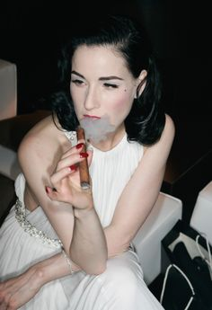 Dita Von Teese--not many women can look this good smoking a CIGAR
