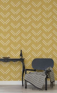 Love mustard hues in the home? This tribal-inspired wallpaper design combines a decorative repeated pattern against a canvas texture. Tie together with gold accents for an elevated look in your living room spaces.