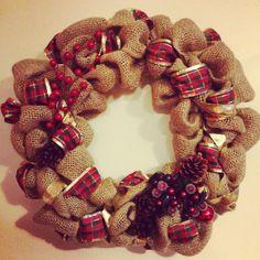 Burlap Christmas wreath.  So easy- burlap, ribbon, cinnamon scented pinecones, ornaments, and berry embellishments.