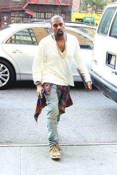 Kanye West wearing Red and Navy Plaid Long Sleeve Shirt, White Long Sleeve Henley Shirt, Light Blue Jeans, Tan Suede Desert Boots Kanye West Shirt, Kanye West Sweatshirt, Fashion Killa, Look Fashion, Urban Fashion, Mens Fashion, Arty Fashion, Yeezy Fashion, Man Style