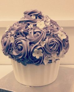 Giant Cupcake ... lavender/purple roses and white chocolate case. My kids made the flowers on top.