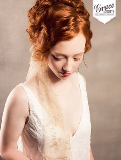 Red Hair set off with ivory skin tones and rose coloured lips #vintageinspiredwedding #bride #redhair
