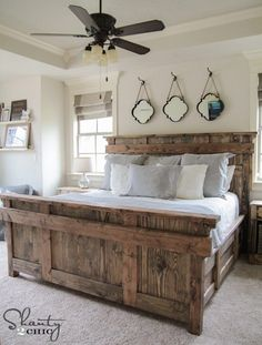 Gorgeous Farmhouse Projects  Hooks and mirrors above bed