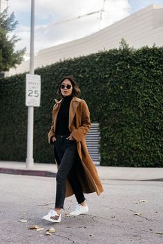 Timeless and elegant, a camel coat is a wise investment that will never go out of style. Add an extra dimension to an all-black look by layering over an oversized maxi camel coat. Finish the...