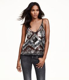 V-neck camisole top in soft jersey with sequined embroidery at front and narrow shoulder straps.