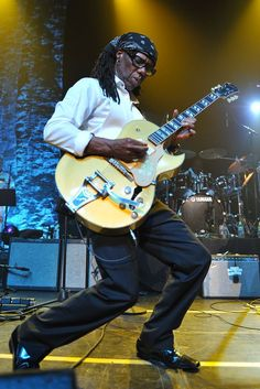 Nile Rodgers. He's a very cool guitarist. Listen to his wide range of work and there's no doubting his credentials...