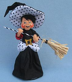 <p> Annalee Doll Description: Open eyes, mouth expression may vary, black hair, black witch hat and dress accented with white and black polka dots, gold buckle, holds broom.</p>