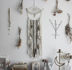 •. ☾ Northern Poetry. ◦☽.⋆ An ode to the white magic of a nordic sorceress... this dreamcatcher is adorned with a real bone found in forest. its embroidered with a traditionnal weaving and a quartz point with protective properties. the nightmares are filtered into a cascade of wool, vintage lace, duck and rooster feathers. Decorated with swarovski crystals and labradorite. The Boudoir du Chamans creations combine the charm of vintage fabrics to the pagan spirit of animist cultures. Each…