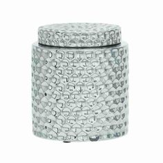 This covered jar features a silver & chrome contemporary style glazing on the body of this piece which gives it an updated yet glamorous look and feel. The body of this silver and chrome cermaic covered jar features an all over modern circular textured motif. This piece is the perfect accent to add to a bathroom vanity to give it a contemporary feel, and would be a great storage piece for your bathroom necessities. You could also place this updated silver and chrome ceramic textured covered ...