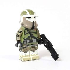 HeroBloks - AT-RT Driver. HeroBloks is an ambitious project aimed at cataloging every LEGO, compatible, bootleg and custom pop culture minifigure. Lego Custom Clones, At Rt, Lego Star Wars, Pop Culture, Projects, Log Projects, Blue Prints