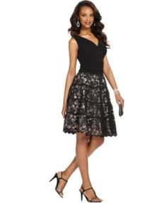 A ruched bodice and gorgeous lace overlay at the skirt make Sl Fashions' dress a sophisticated and feminine pick for your next celebration. | Polyester/spandex; lining: polyester | Dry clean | Importe