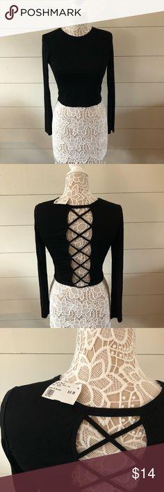 Cross cross black crop top Fashion nova cross cross back black crop too. NWT. Fashion Nova Tops Crop Tops
