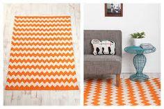 Orange chevron rug in front of fire?