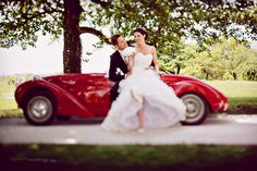 A red car is beautiful for wedding day.