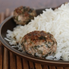 Lemony Swiss chard meatballs served with fluffy white rice