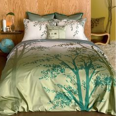 Amelie Green Duvet features graphic treetop silouettes layered in tonal greens over a graduated background in fresh green cloud-soft cotton sateen.  Available in Twin, Queen or King.