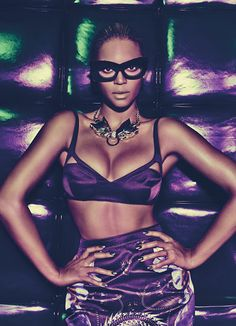 Givenchy by Riccardo Tisci's silk satin bra and skirt, mink glasses, and necklace.
