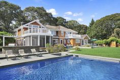 PRIVATE WATERFRONT RETREAT QUOGUE, NY 5 Beds | 4 Baths 5300 sq ft OFFERED AT $4,199,000