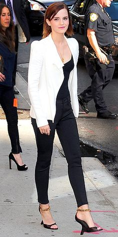 EMMA WATSON  Thank you, Emma, for giving us a fresh way of wearing our favorite black J Brand skinnies. She dresses hers up with a chic white blazer, glam gold-chain Tom Ford heels and sleek strands.