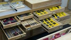 Home Workshops -- Several of the miter station's storage drawers were sized specifically to fit commercially available parts bins, which nest perfectly into the drawers.