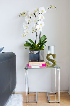 Sydne Summer's West Hollywood Home // home decor // grey couch // side table // monogram // living room // Photography by