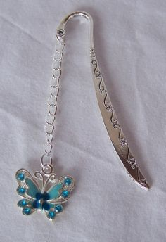 Blue Butterfly On A Scrolled Bookmark