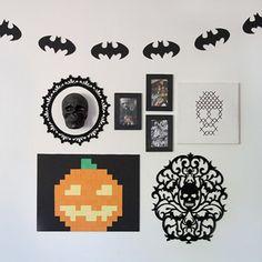our halloween house tour geeky halloween decorations including a batman garland pixelated pumpkin dexter table and nintendo art