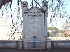 Fountain of Tor di Nona. Christina of Sweden in the 17th century commissioned a theatre on the shore of the Tiber. At the end of the 19th cent during the building of the banks of the river the theatre was destroyed and this fountain was made for remembrance. The epigraph tells the history and the decorations alluding to Apollo (playing a lira). The theatre had also the name of Apollo