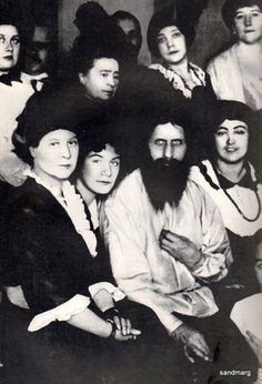 Rasputin with friends (all female) soon before his assassination in 1916.