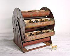 Vintage Metal Carousel Parts Bin / Metal Organizer / Industrial Storage. $78.00, via Etsy.