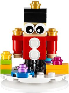 The holiday season is just around the corner and it looks like there's an image of one of the new ornaments LEGO will be releasing this year with the Toy Soldier Lego Christmas Ornaments, Christmas Tree, Lego Decorations, Toy Soldiers, Red Ribbon, Legos, Minions, Seasons, Toys