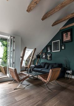 Stylish and sophisticated sofa corner with a dusted green wall. A classic look with Mies van der Rohe's designer chairs.
