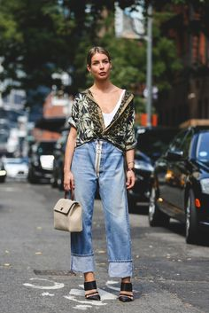 An Ode To Our Favorite Opposites-Attract Style Move #refinery29  http://www.refinery29.com/wear-heels-jeans#slide-6  No jeans are too oversized for this styling trick. Embrace a wide cuff to show off the shoes, and play with proportions by sporting a billowy, printed blouse up top....