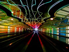 I absolutely hate the ridiculously long walk and the almost vertical escalators but this is one of my favorite airports simply for its gorgeous rainbow walkway! Chicago O'Hare Airport walkway