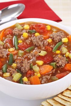 Recipe including course(s): Entrée; and ingredients: celery, chicken broth, frozen mixed vegetables, ground beef, onion, onion soup mix, tomato sauce, water