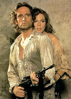 Michael Douglas and Kathleen Turner as Jack T. Colton and Joan Wilder in Romancing the Stone: I was obsessed with this movie when I was young. My brothers and I knew every word! Now my daughter does too!!