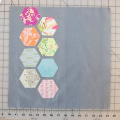 Make a quick modern quilt block featuring the hexagon and 50% negative space. Step-by-step directions by Jen Eskridge. Use English Paper Piecing or facings.