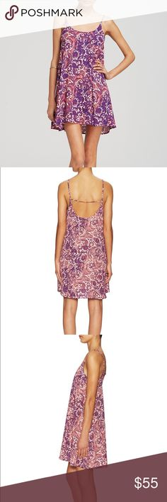 Free People Emily Slip Dress Breezy flowy slip dress from Free People! Beautiful pink and purple paisley print. Size small, EUC. Scoop neck, sleeveless, horizontal back strap, pullover style. Perfect for summer and fall! Free People Dresses Mini