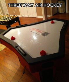 Three-way air hockey <<<< I need this like I need air... hockey!